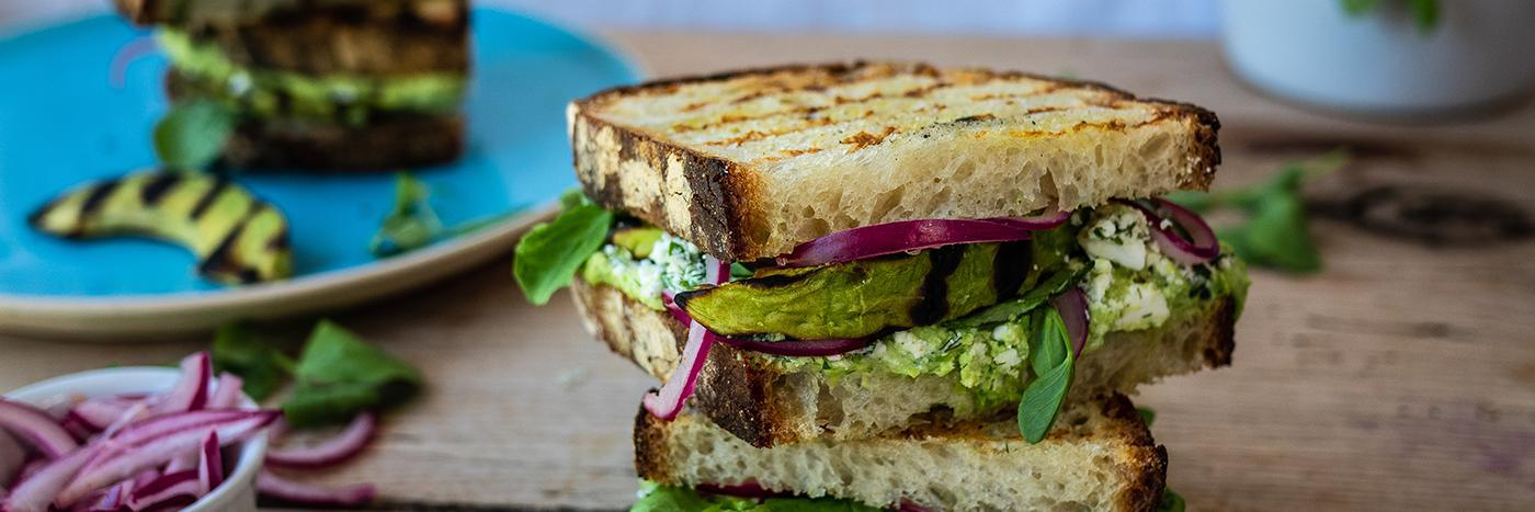 Pea hummus, feta, griddled avocado and pickled onion sandwich
